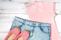 Female casual summer clothes collection. Overhead on a simple background royalty free stock images