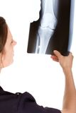 Female Caucasian doctor examining an x-ray Royalty Free Stock Images