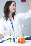 Female Caucasian Laboratory Staff Researching Liquids in Lab Stock Photography