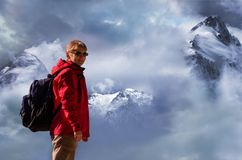 Female caucasian mountain climber in front of peaks with snow Stock Photography