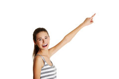 Female caucasian teen pointing up with a finger. Royalty Free Stock Images
