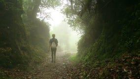 Female caucasian tourist trekking walking at himalayan mountains, Nepal. Female Caucasian tourist trekking walking along narrow footpath at himalayan mountains stock footage