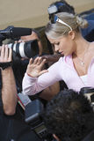 Female Celebrity And Paparazzi royalty free stock photos