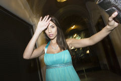 Female Celebrity Shielding Face royalty free stock image