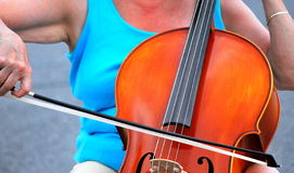Female cellist. Mature female cellist performing in concert outside stock photos