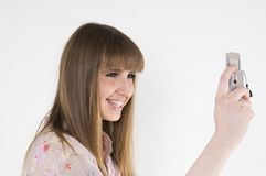 Female with cellular phone Stock Images