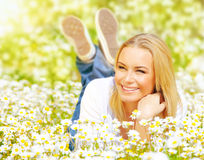 Female on chamomile field Stock Image