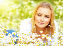 Female on chamomile meadow Stock Photos