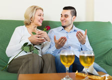 Female chatting with young boyfriend Stock Images