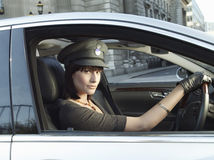 Female Chauffeur Driving A Car Stock Photos