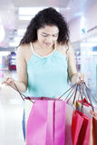 Female checking a shopping bag in the mall Royalty Free Stock Photos