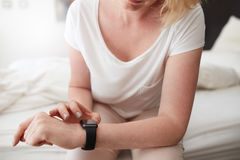 Female checking time on her wrist watch Stock Photo
