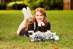 Female cheerleader with red hair Royalty Free Stock Photos