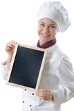 Female chef. Portrait of a female chef with a menu blackboard isolated over white stock photo
