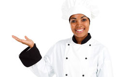 Female chef. Half length portrait of african american female chef over white Royalty Free Stock Photography