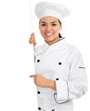 Female Chef. Stock image of female chef holding blank sign with copy space and isolated on white background stock images
