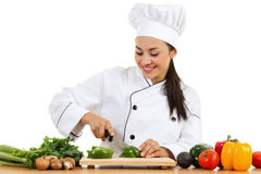 Female chef. Stock image of female chef preparing food isolated on white background royalty free stock images