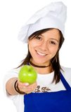 Female chef with an apple Royalty Free Stock Image