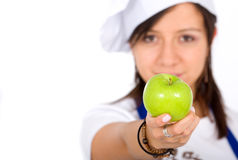 Female chef with an apple Royalty Free Stock Images