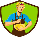 Female Chef Bandana Mixing Bowl Crest Retro. Illustration of a female chef with bandana holding spatula and mixing bowl mixing viewed from the front set inside Stock Images