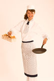 Female chef with chanterelle mushrooms, pan and ap Stock Images