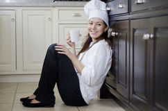 Female chef on a coffee break Royalty Free Stock Image