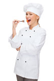 Female chef, cook or baker with fork and tomato Stock Image