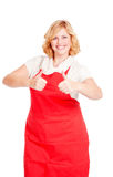 Female chef cook showing thumbs up Stock Photos