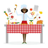 Female chef cooking. Stock Photos