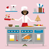 Female chef cooking. Female african american chef cooking on pink background. Restaurant worker preparing food. Chef uniform and hat. Table and cafe equipment Royalty Free Stock Photography