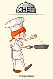 Female chef cooking with a pan Royalty Free Stock Photography