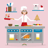 Female chef cooking. Royalty Free Stock Image