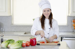 Female chef cutting vegetables Royalty Free Stock Images