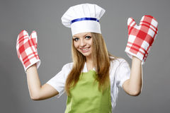 Female chef in different poses isolated on gray Royalty Free Stock Photo