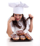 Female chef with donuts Stock Photos
