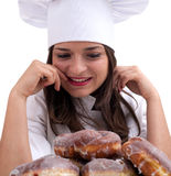 Female chef with donuts Royalty Free Stock Photography