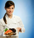 Female chef with frozen seafood Stock Image