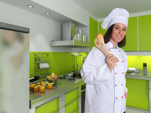 Female Chef in a green designer kitchen Royalty Free Stock Photography