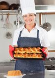 Female Chef Holding Baked Bread Stock Images