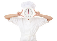 Female chef holding a big clock Royalty Free Stock Images