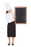 Female chef holding blank menu board Royalty Free Stock Images