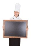 Female chef holding blank menu board Royalty Free Stock Photography