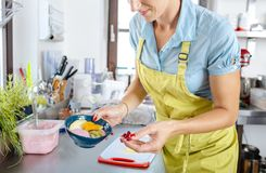 Female chef holding bowl with fruits and cream royalty free stock image