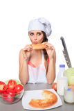 Female chef holding a bread with expression Stock Photo