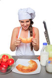 Female chef holding a bread with expression Royalty Free Stock Image