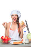 Female chef holding a bread with expression Stock Image