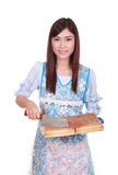 Female chef holding the chopping block and knife Royalty Free Stock Photography