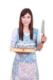 Female chef holding the chopping block and knife Stock Photo