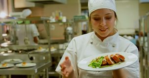 Female chef holding dish and showing ok sign 4k