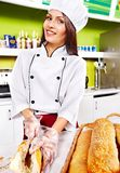 Female chef holding  food. Stock Images
